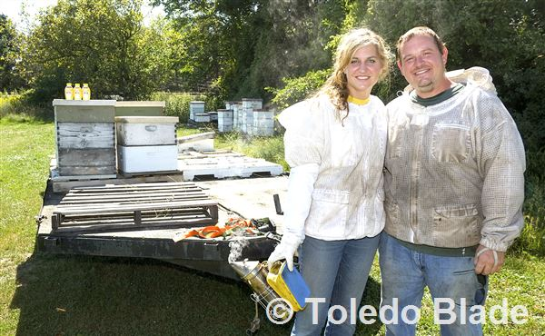 Your beekeepers, Arik and Beth Bench